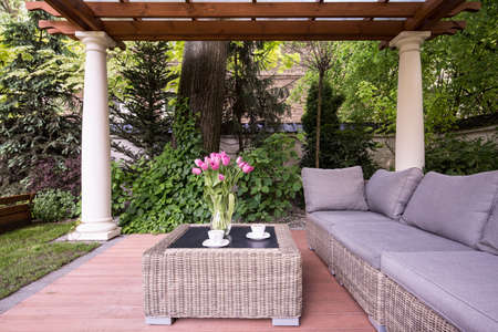 Picture of relaxation space in garden with elegant rattan furniture Stok Fotoğraf - 45136069