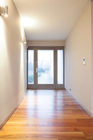 unfurnished: Empty unfurnished hall in exclusive detached house Stock Photo