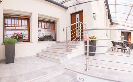 new entry: Image of entry and terrace in beautiful new mansion Stock Photo