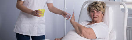 reject: Elderly patient is unwilling to take her medicine Stock Photo