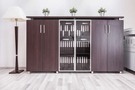 office cabinet: Modern home office interior with wooden furniture