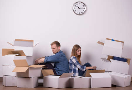 moving out: Young couple is tired because of packing up