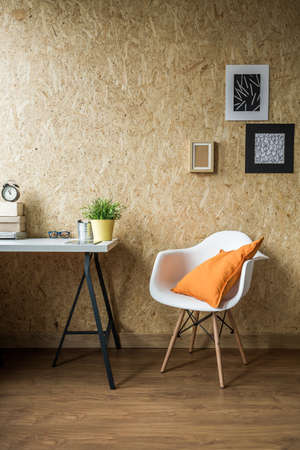 modern apartment: White chair with orange cushion in wooden interior