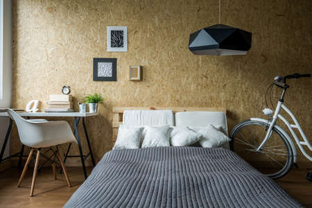 modern bedroom: Pallet bed and wooden wall in ecological bedroom Stock Photo