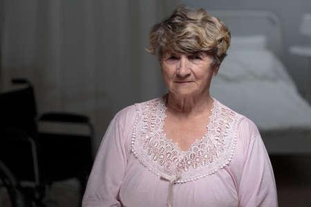 senior woman: Ill senior woman staying in nursing home