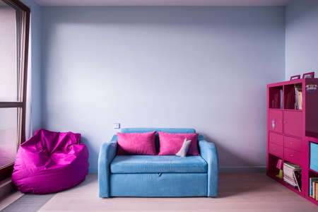 teens playing: Blue and rose furniture in girls room