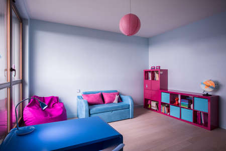 fashionable girl: Blue and rose furniture in bedroom for little girl Stock Photo