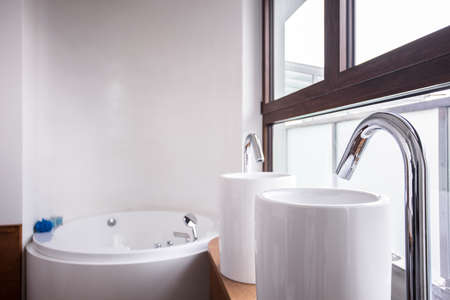 handbasin: Two washbasins and bath in modern bathroom
