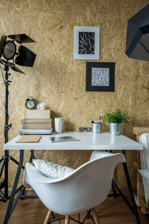 home office desk: Modern atelier of young photographer - vertical view