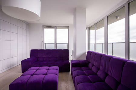 quilted: Violet quilted sofa in modern sitting room Stock Photo