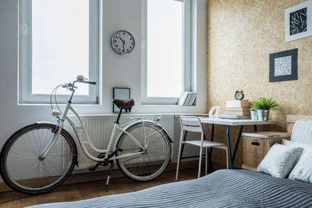 teen bedroom: Close-up of girls bike in contemporary bedroom