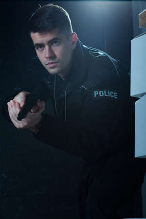 cop: Image of young man working as policeman Stock Photo