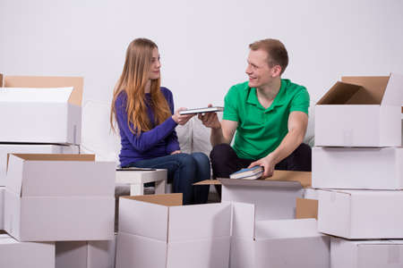 moving out: Young couple is moving out from parents Stock Photo