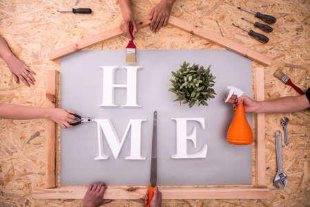 Metaphor of householders renovating house - horizontal view
