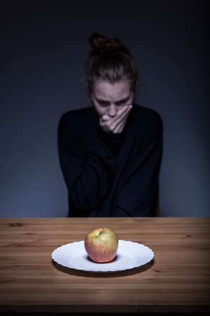nausea: Image of a lonely anorexic having nausea Stock Photo