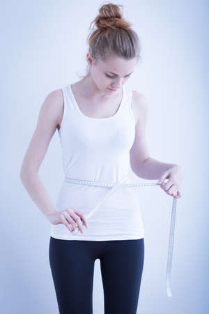 skinny girl: Photo of a skinny girl measuring waist