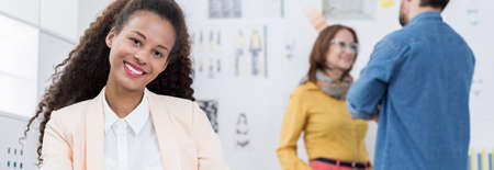 panorama: African American woman working in modern workplace