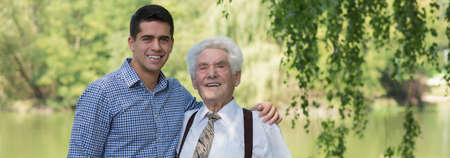 spending: Grandfather is spending time with his grandson