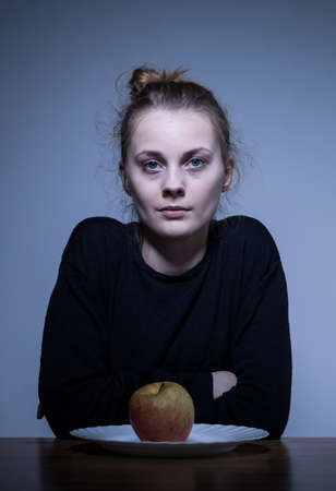regain: Portrait of a devastated female with eating disorder