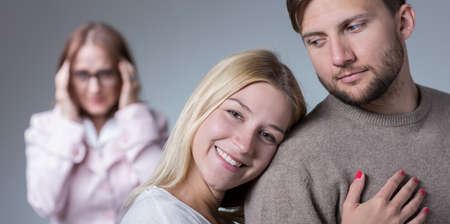 possessive: Womans son is very happy with his wife Stock Photo