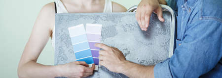redecorating: Couple choosing right color for redecorating house