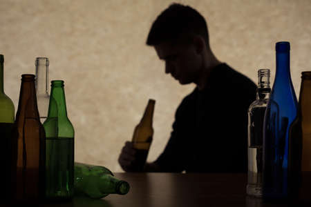 alcoholism: Adolescent drinking beer - alcoholism among young adults Stock Photo