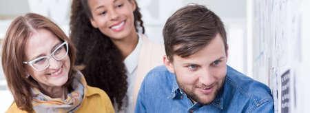 collaborators: Happy male and female collaborators working together Stock Photo