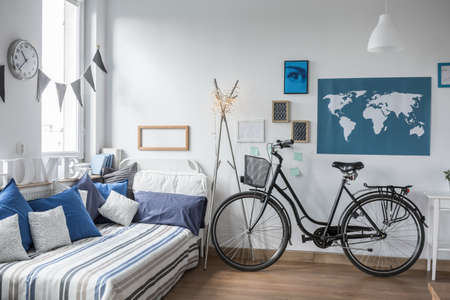 urban apartment: Urban bike standing in designed teenager room Stock Photo