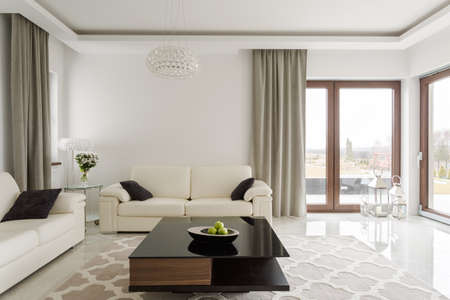 apartment: Photo of luxurious leather sofa and small wooden table