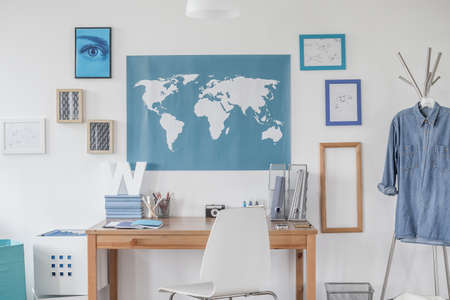 bedroom wall: Blue map on the wall in boys room Stock Photo