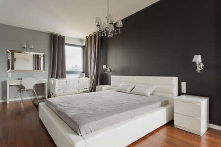 Image of king size bed with headboard in fancy bedroom Stok Fotoğraf