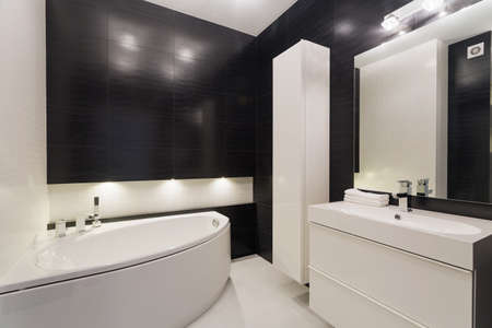 Image of luxurious black and white bathroom with elegant tiling Stock Photo