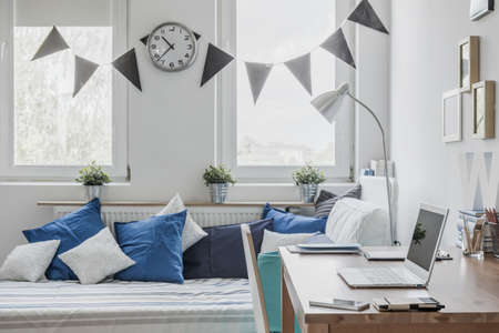 boy bedroom: Sunny bedroom for boy in the house