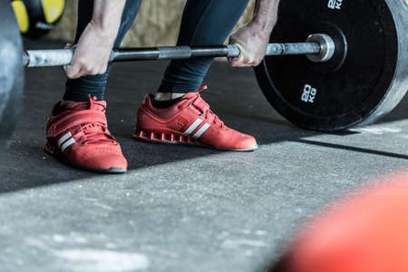 weight lifter: Man practicing weight lifting in the exercise room Stock Photo
