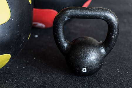 workouts: Close-up of black heavy kettlebell in the exercise room Stock Photo