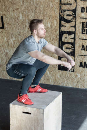 workouts: Man on the plyo box during crossfit training