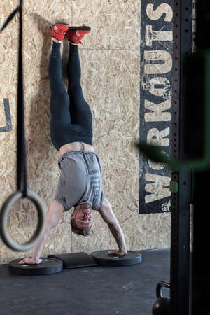 handstand: Man practicing handstand during crossfit training Stock Photo