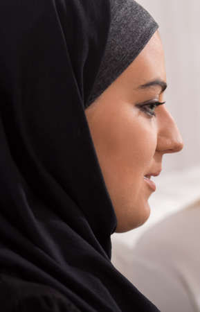 a close up: Close up of beautiful islamic woman in traditional headscarf Stock Photo
