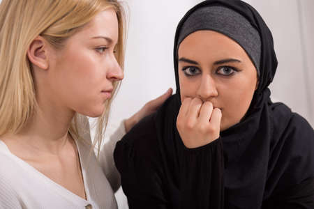 immigrant: Image of female immigrant from arab country with friend