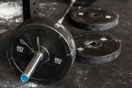 Close-up of heavy barbell on the gym floor Foto de archivo