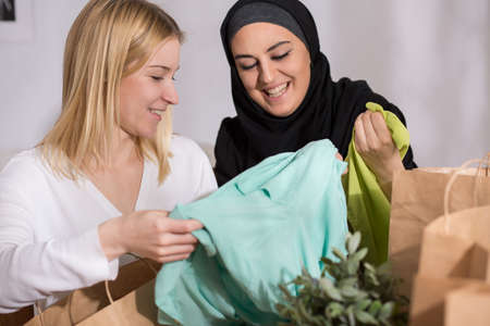 after shopping: Picture of happy female after shopping with her muslim friend