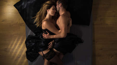 bed sex: Sensual couple during sexual moments in bed Stock Photo