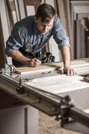 hardworking: Hardworking young craftsman working at the workbench