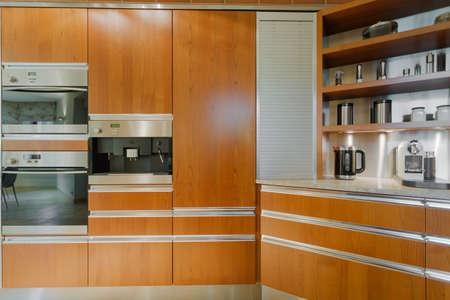 worktops: Close up of contemporary design kitchen interior with wooden furniture