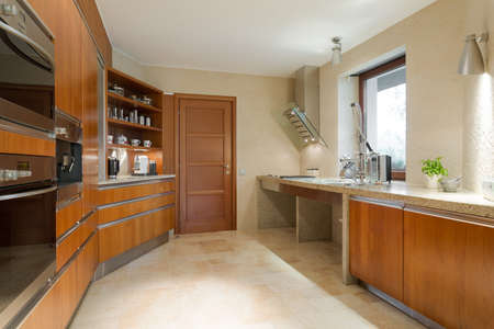 worktops: Photo of new designed spacious wooden kitchen Editorial