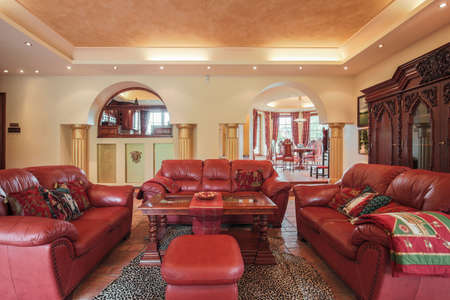 leather furniture: Photo of colonial style living room with leather furniture
