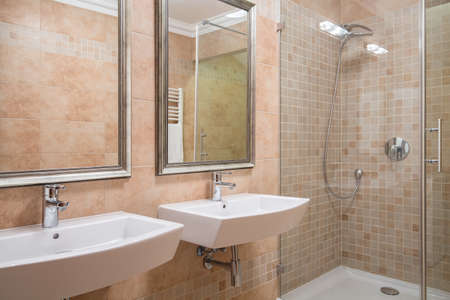 sinks: Photo of exclusive bathroom with shower and two basins