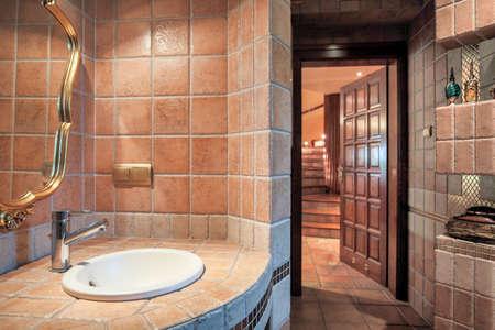 wood door: Photo of luxurious warm bathroom with decorative mirror Stock Photo