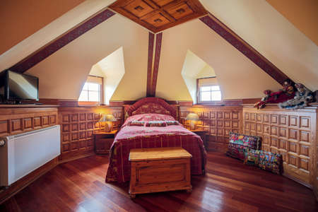 nightstands: Photo of single bed in old style bedroom