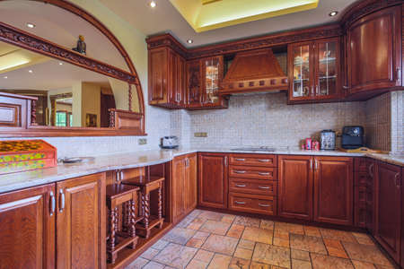 kitchen tile: Photo of spacious wooden kitchen interior neat furnished